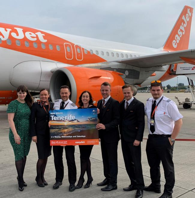 LJLA's Head of Marketing Katie Elliott (far left) joins easyJet cabin crew to celebrate the airline's new Tenerife service from Liverpool