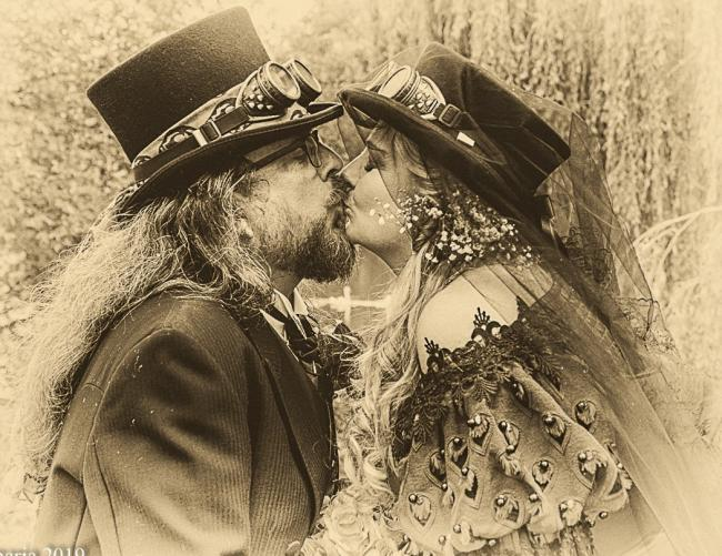 Graham and Victoria share a tender kiss at their Steampunk wedding Pictures: Donna Maria Long
