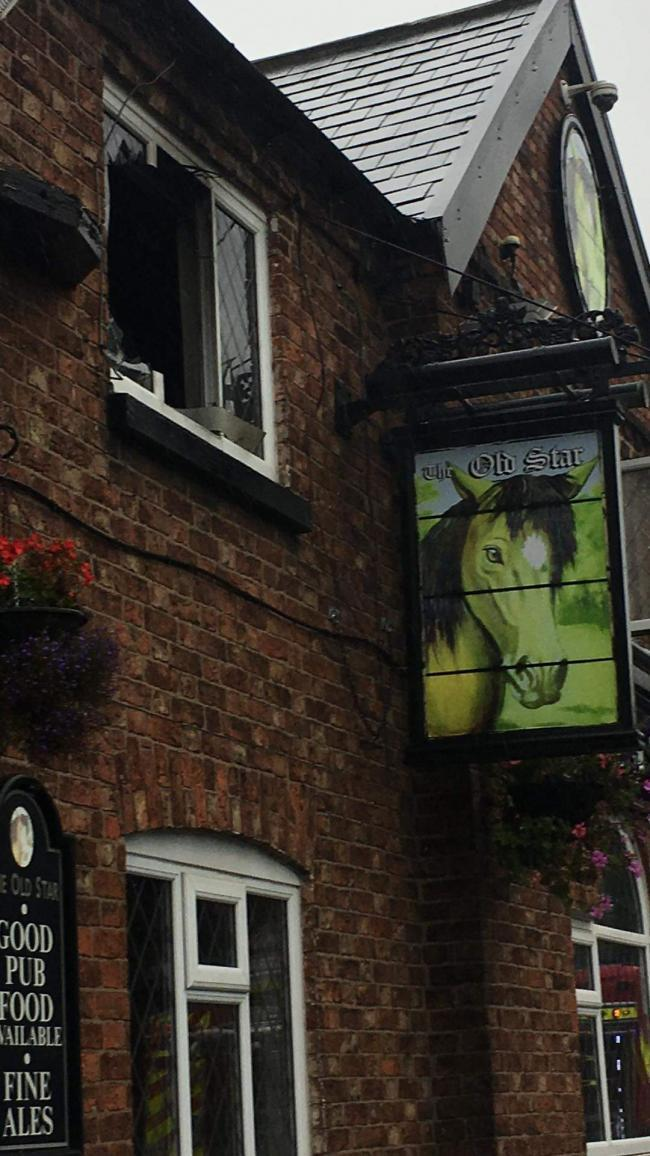 Stan was pulled from this window above The Old Star pub in Swanlow Lane