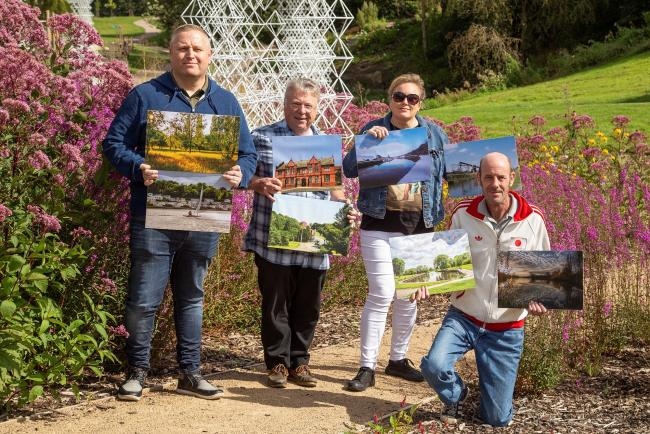 Four of the winning photographers Terry Hamlett, Chris Brennan, Lisa Lacking and Paul Moses with some of the calendar's winning images Photo: Jan Graham