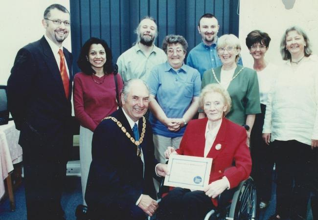 Citizens Advice staff and volunteers at Brunner Guildhall in 2001 as the former mayor of Vale Royal Cllr Nicky Harris presents a long service award to Freda Robson, one of the first volunteers