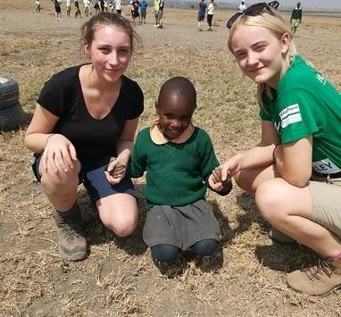 Molly Warburton and Olivia Yardley meet the Kenyan children