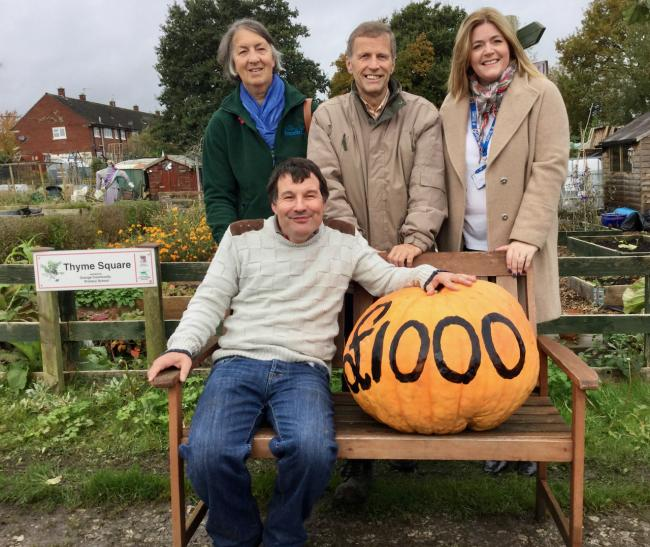 Jo Rafferty fromMid Cheshire Foodbank, Mike Allen, chairman Over Allotments Association, Vickie Baddeley from St Luke's Hospice with Danny Weedall and a big pumpkin he grew on his plot Picture: John Malam