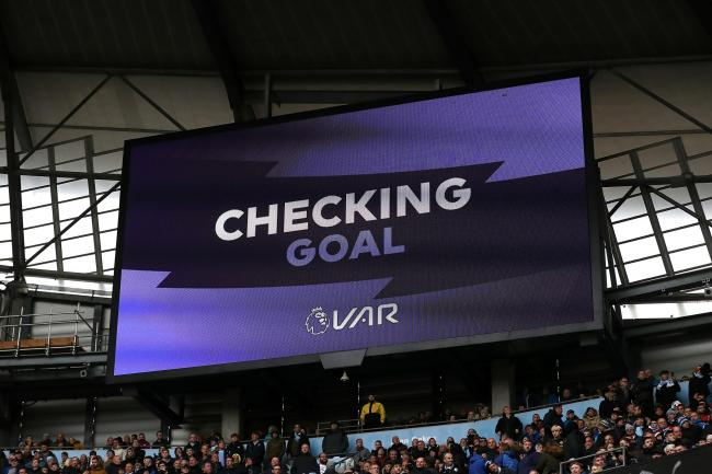A large screen showing a VAR check