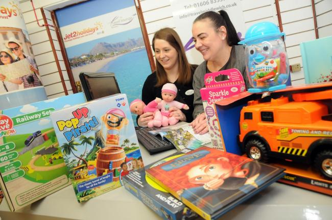 Lynsey Bills and Joanne Lightfoot at The Travel Lounge with some of the gifts donated to their Christmas toy appeal