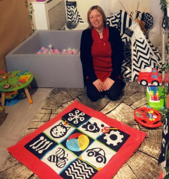 Jodie Hall, baby and pre-school practitioner, in the new baby room at St Chad's Pre School