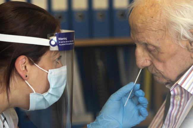 A care home resident undergoes a coronavirus test