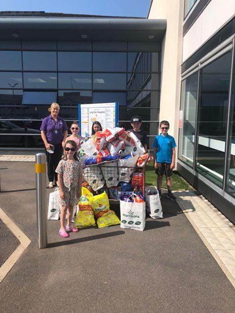 Brothers Jack and George Connor, sisters Layla and Jessica Ravenscroft and Mia Glover deliver a giant load of treats to Leighton Hospital