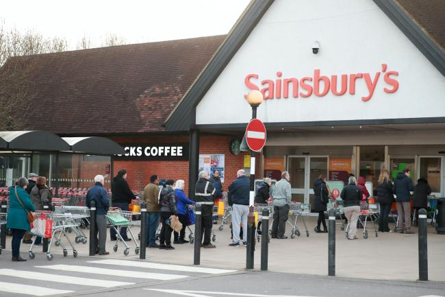 People queuing up outside Sainsburys