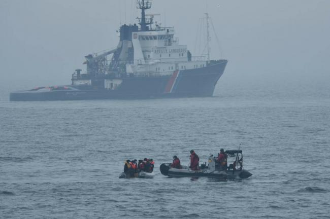 Migrants who were found on a boat off Boulogne-sur-Mer by French authorities