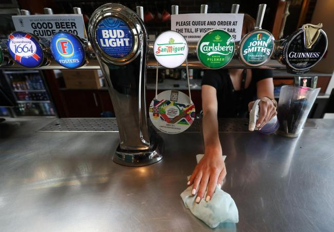 Pubs and restaurants across the country are set to reopen tomorrow, Saturday, with social distancing measures in place (Credit: Yui Mok/PA Wire)