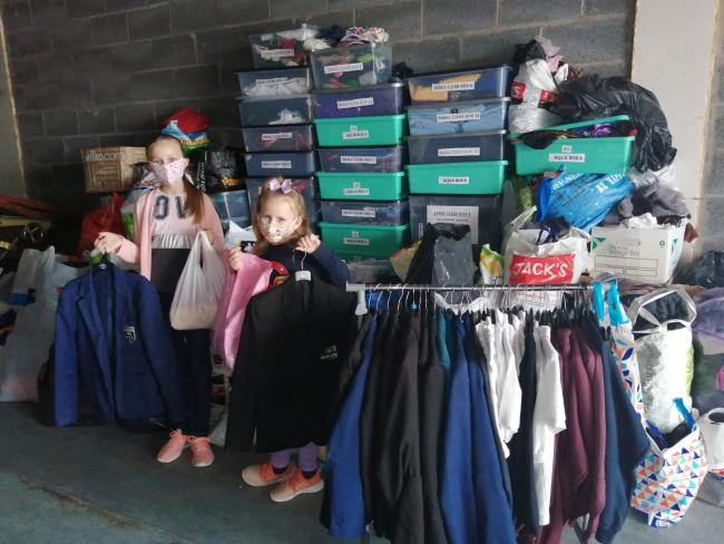 Sisters Emily and Charlie have been helping their mum Emma Ball to sort uniforms for Tuesday's Winsford Uniform Exchange