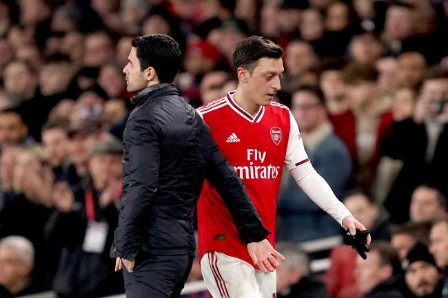 Mesut Ozil and manager Mikel Arteta look set to part ways