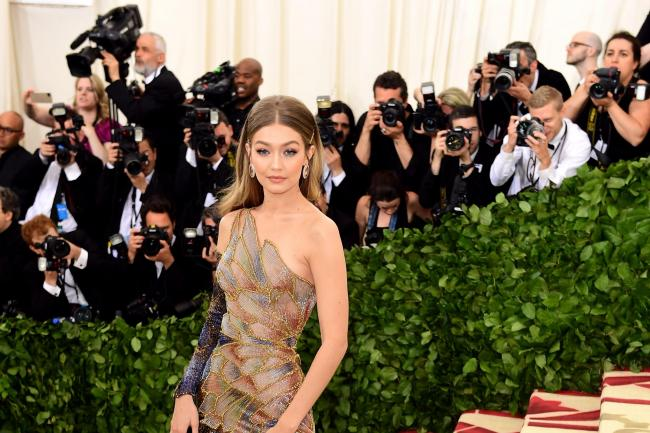 Gigi Hadid holds an expressionless expression toward the camera