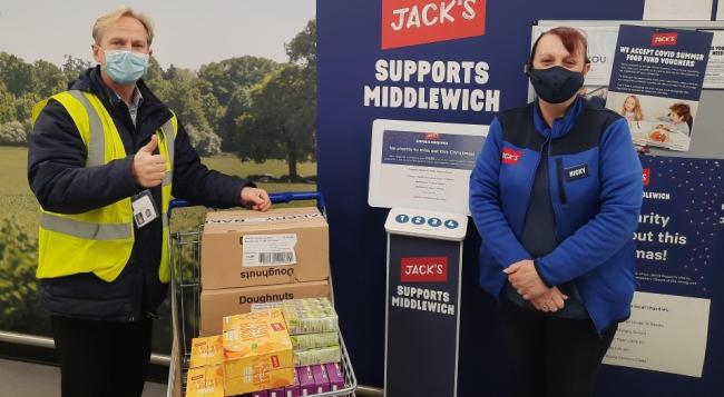 Steve Wiseman, assistant headteacher of Middlewich High School receives breakfast treats and lunchtime snacks from Jack's