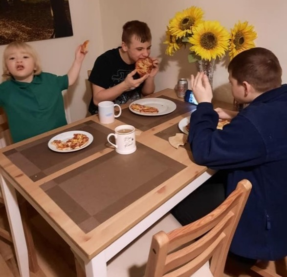 Families enjoy eating food cooked together