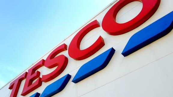 Tesco commit to changes to all UK stores amid shareholders junk food row. (PA)