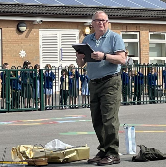 Children and staff at Wharton CE Primary School say goodbye to site manager Ian Miles with memory books