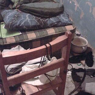 An 11-year-old boy was forced to live in a squalid former coal bunker by his mother and stepfather