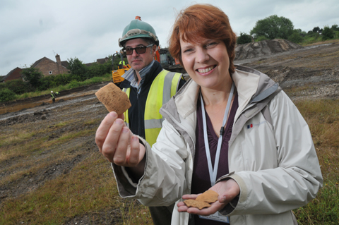 Jeremy Bradley from Oxford Archaeology North with Kerry Fletcher holding Roman pottery thought to be from the 1st century