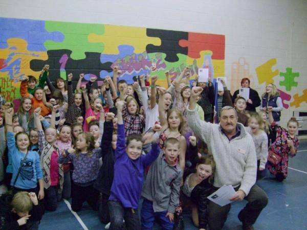 Clr Mike Kennedy with children from New Images youth club