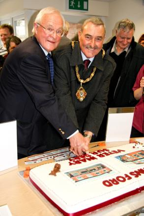 Derek Carter cutting the cake alongside mayor, Clrr Mike Kennedy, at the official opening of Winsford Veterinary Surgery's new High Street headquarters