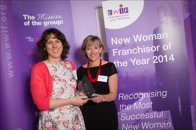 Vicky Matthews, left, and Caroline Gowing, pick up their award.