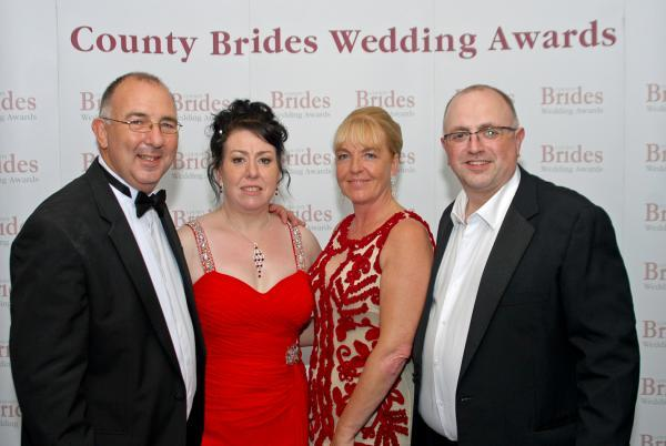 Cherish Bridal's Tracy Hollinshead, second from left, with Andrew Hollinshead, far right, and County Brides managing directors Duane and Dawn Thornborough. Pic by Alan Harding.