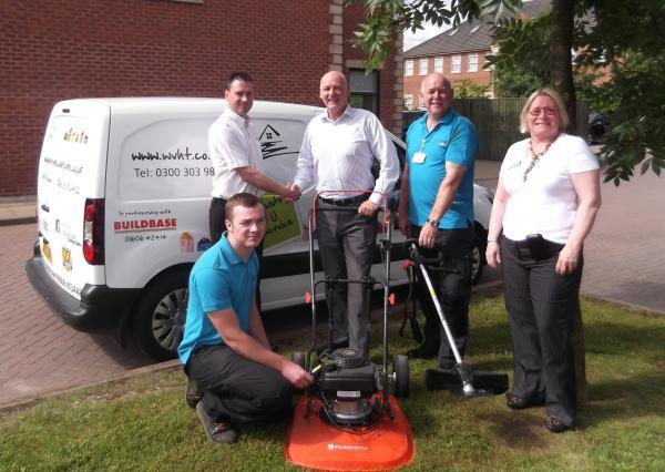 Buildbase staff hand over the equipment to Weaver Vale Housing Trust