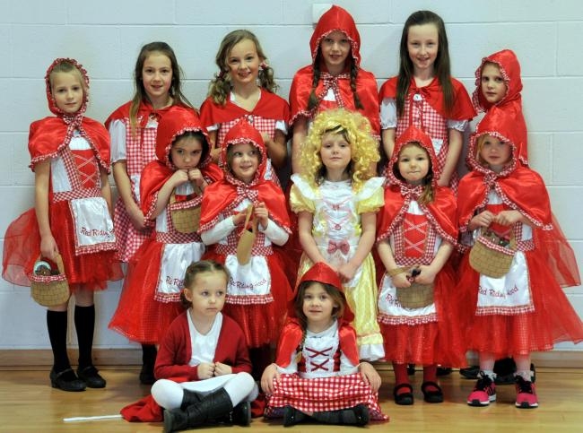 Goldilocks is surrounded by Little Red Riding Hoods