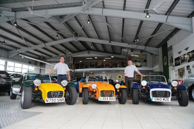 Oakmere Motor Group Jonathan Jarratt, left, with three of his Caterham Sevens and sales manager Steve Jeavons
