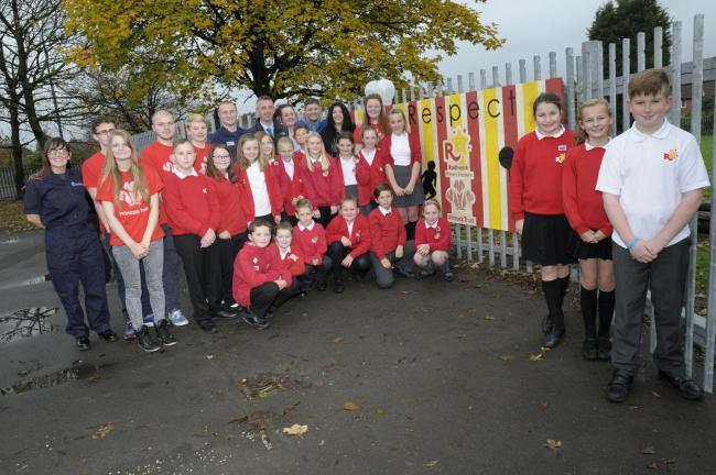 The Prince's Trust team and pupils at Rudheath Primary Academy next to one of the mural boards