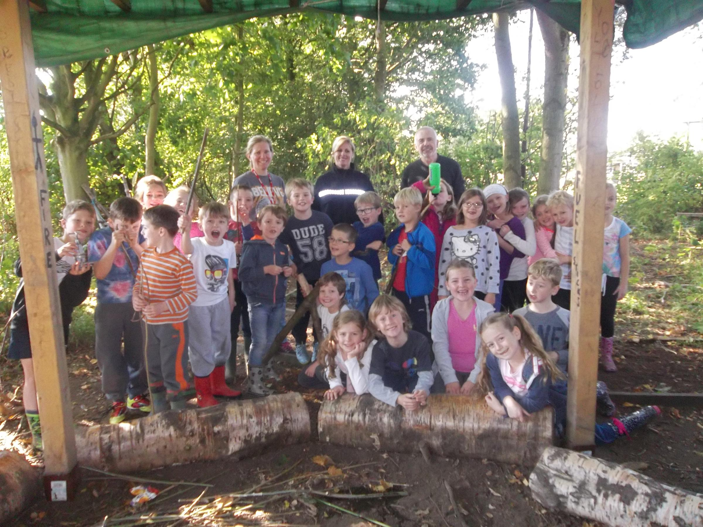 Year three pupils with, from left, parent Mrs Bradley, PCSO Diana Wiggins and Forest School practitioner Shaun Agnew