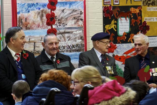 The ex-servicemen at the Remembrance assembly. Picture by Duncan Cowley