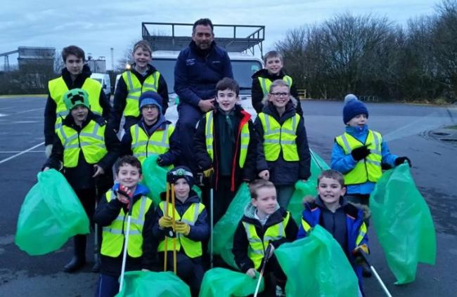 Cubs take part in Clean for the Queen by collecting litter