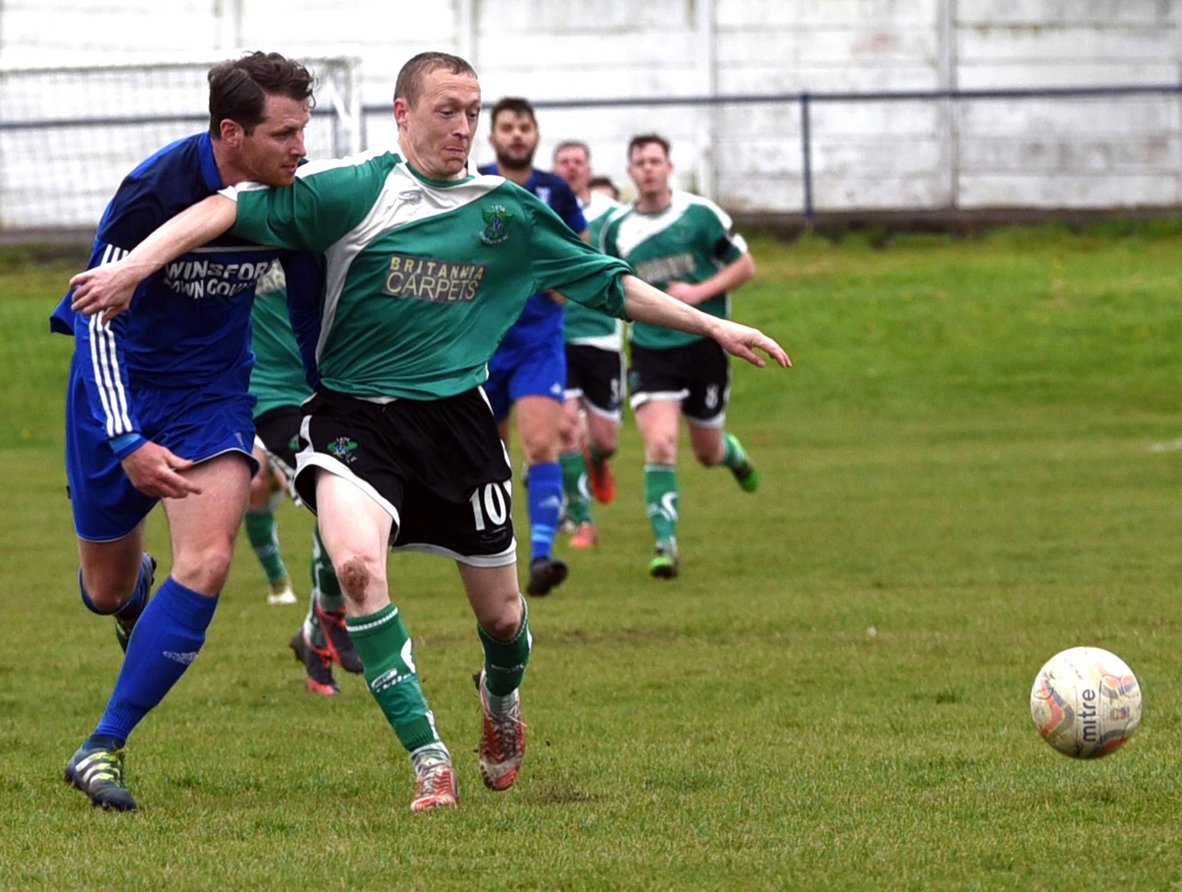 Scott McGowan, right, resists James Rothwell's attempt to stop him during 1874 Northwich's meeting with Winsford in April. Picture: M Darlington Photography