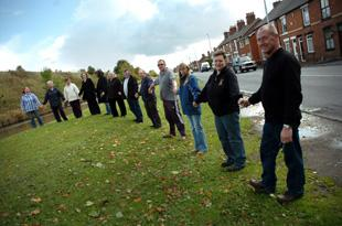 Protestors form a human chain along the canal in a bid to save the Middlewich swans
