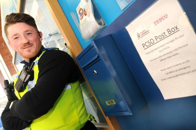 PCSO Ollie Hopwood at the new PCSO postbox in Tesco, where people can post information to him.