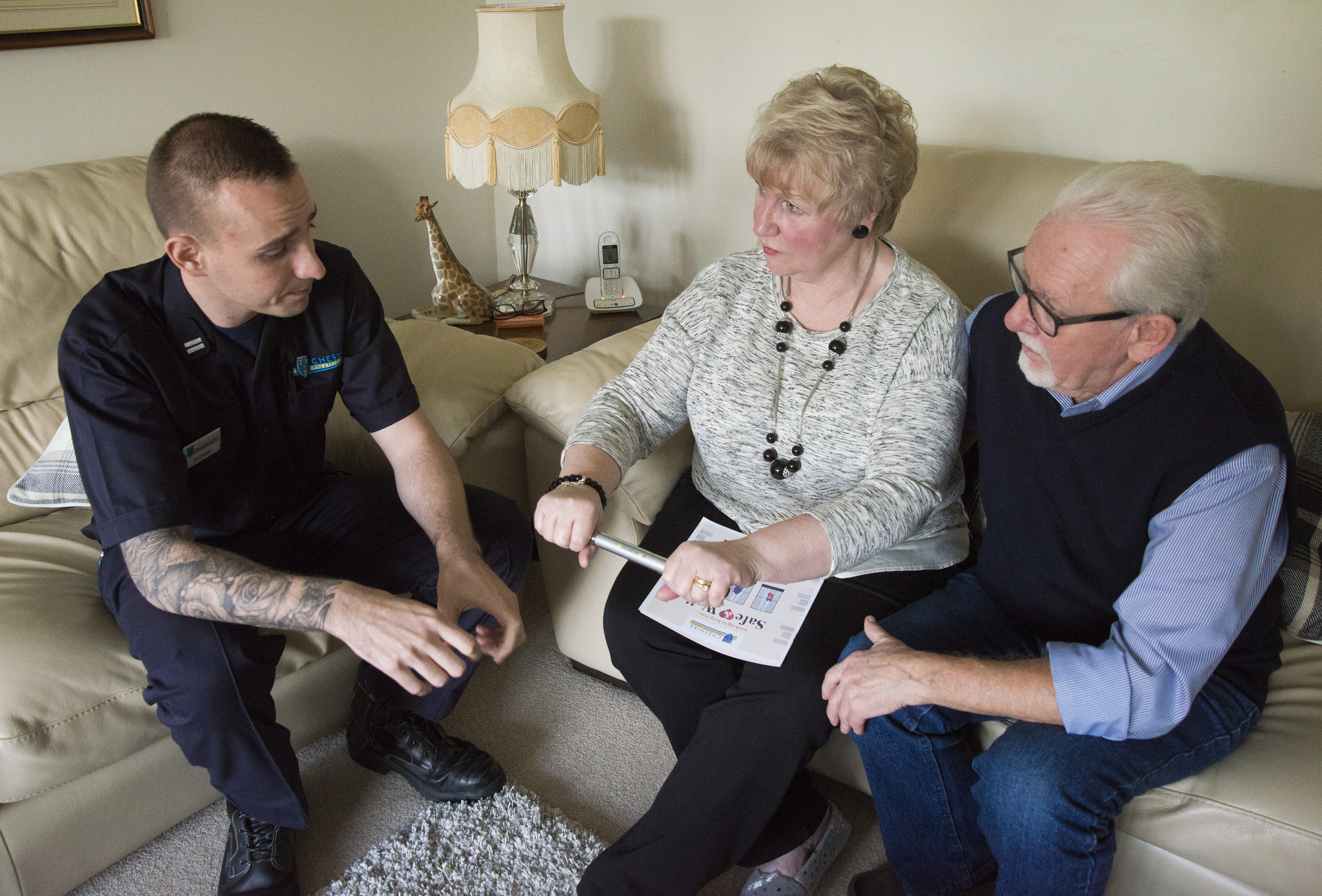 A couple being given Safe and Well advice from a Cheshire firefighter