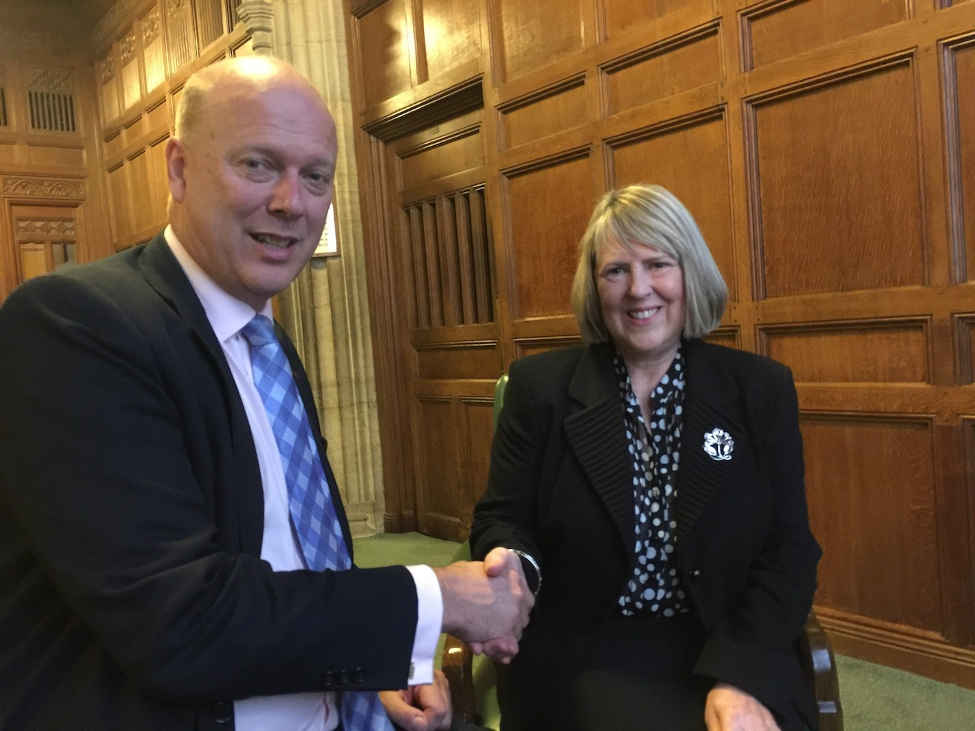Fiona Bruce MP with the Secretary of State for Transport, The Rt Hon Chris Grayling MP in Parliament