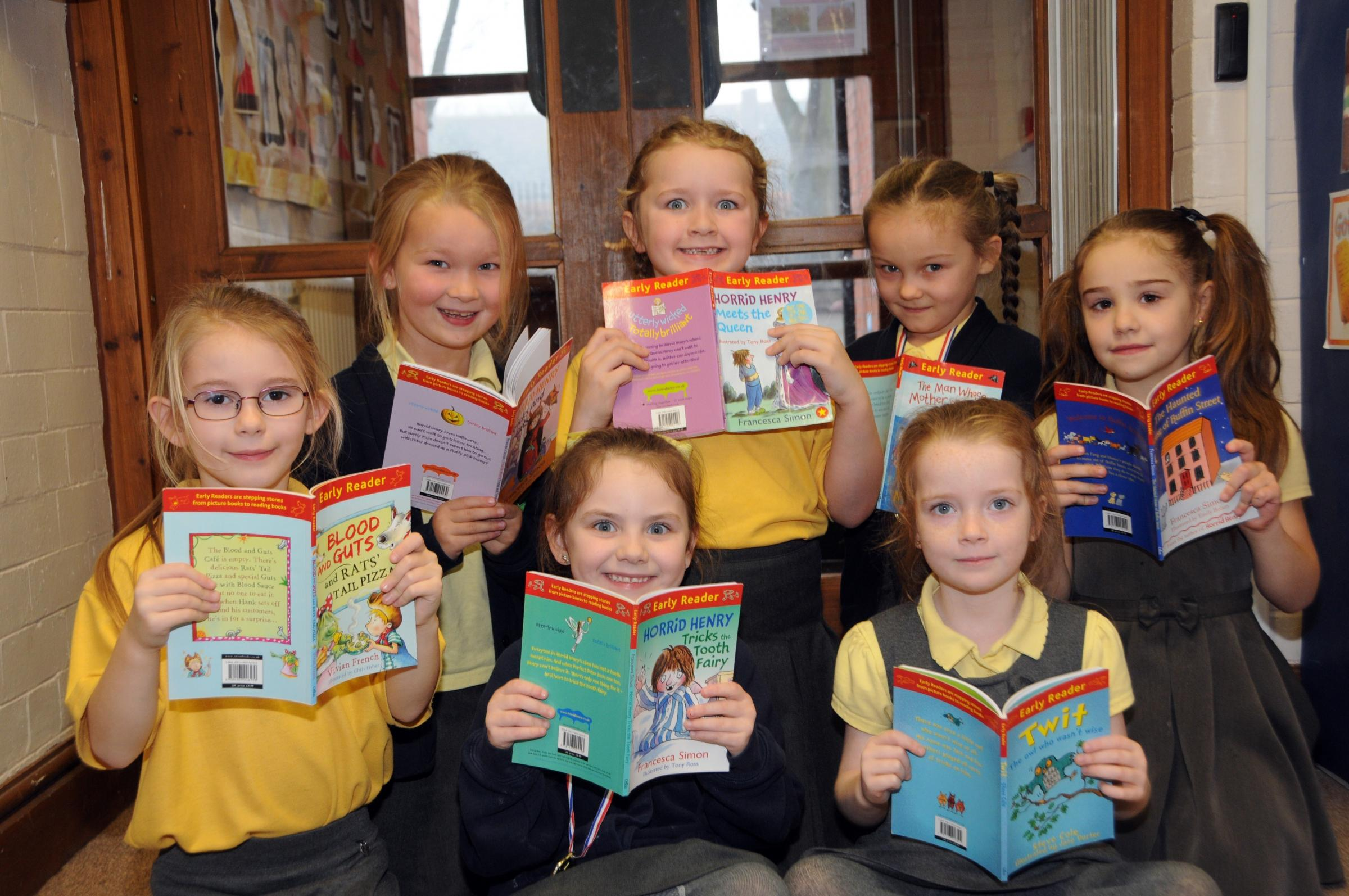 Seven pupils at Darnhall Primary School were presented with new books after passing their reading targets with flying colours