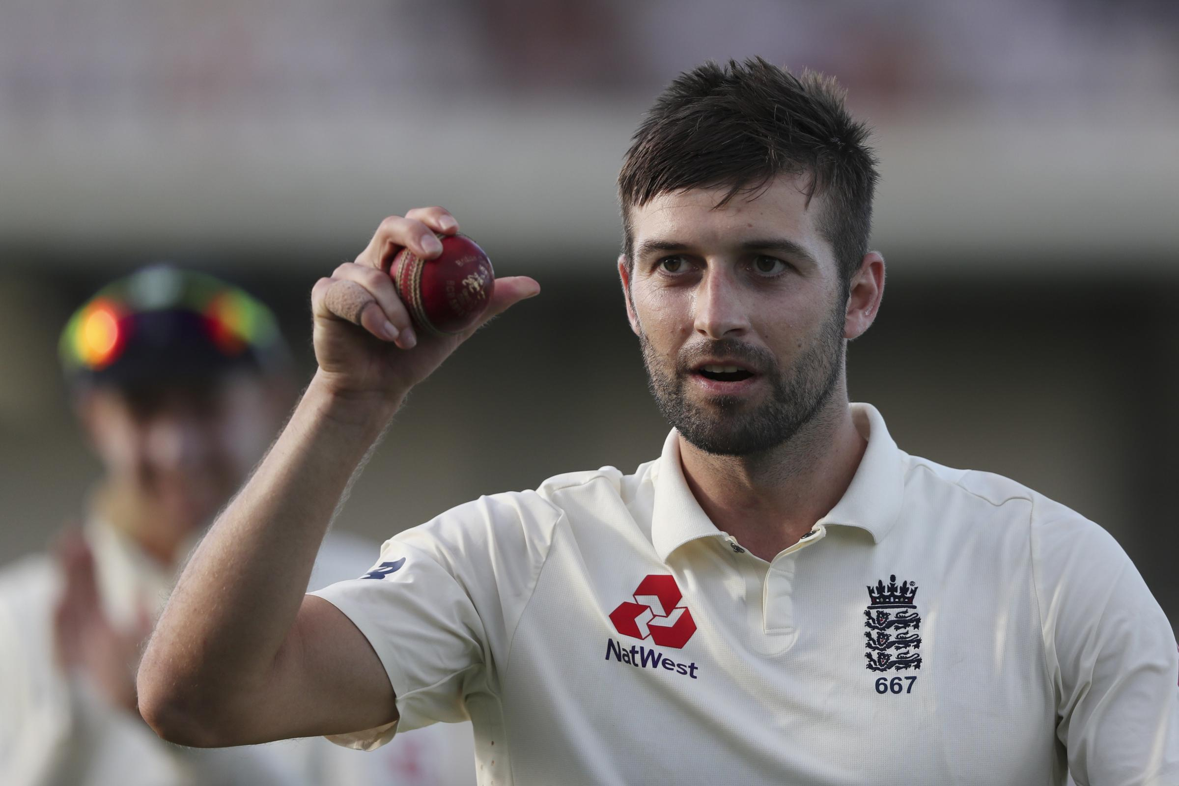 England's Mark Wood shows the ball