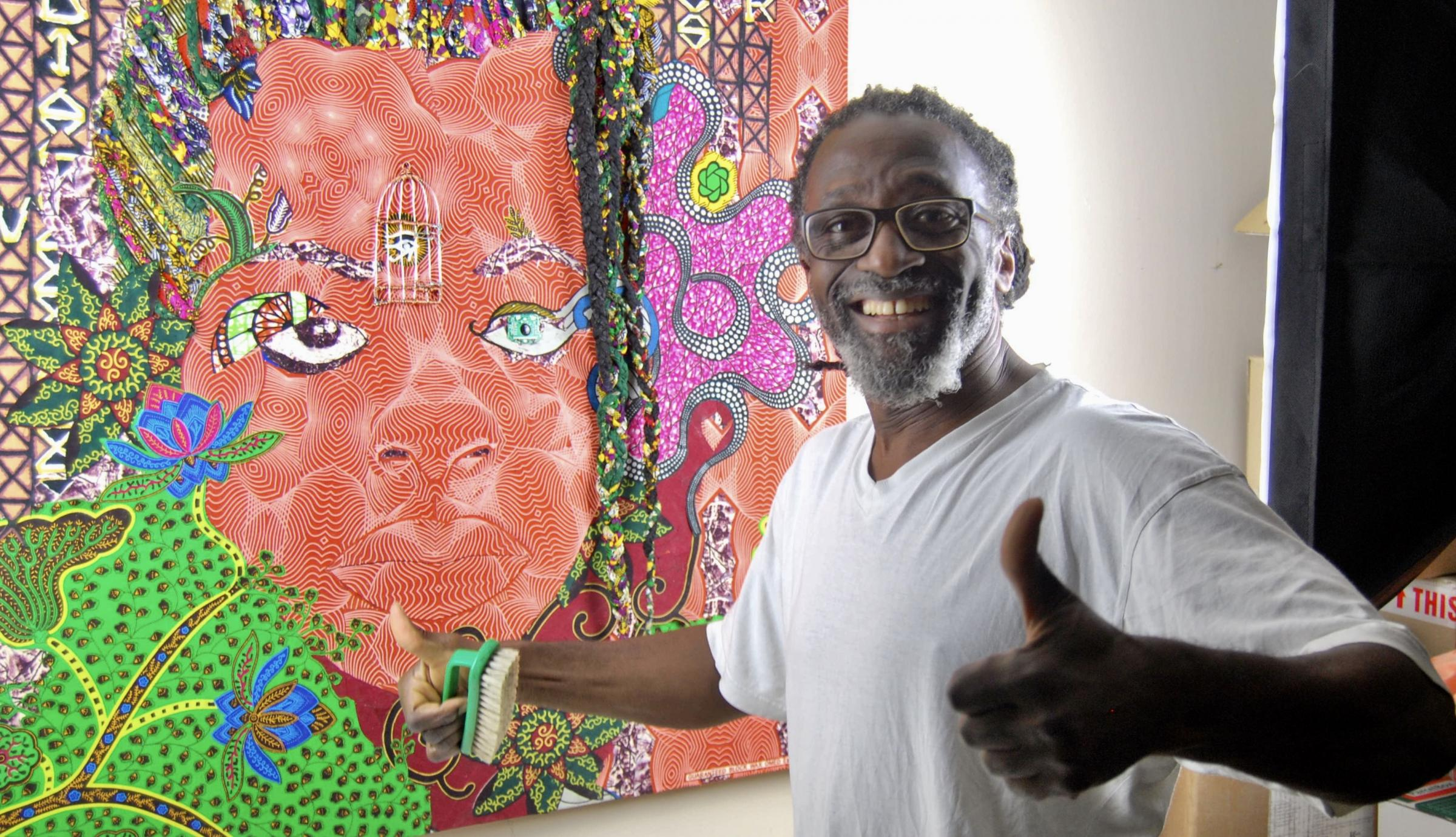Kwame completing his artwork, Influences