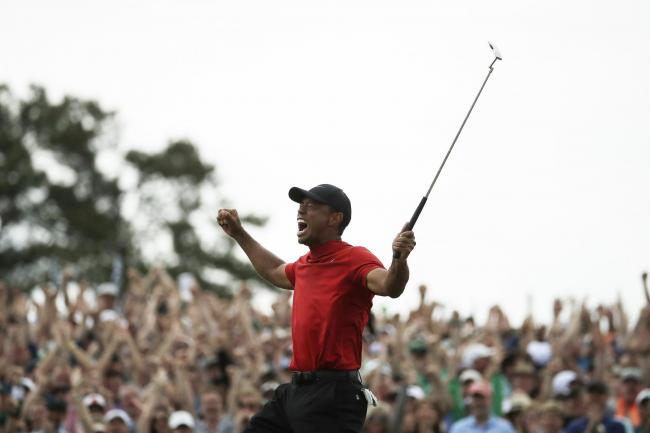 Tiger Woods celebrates completing one of sport's greatest comebacks