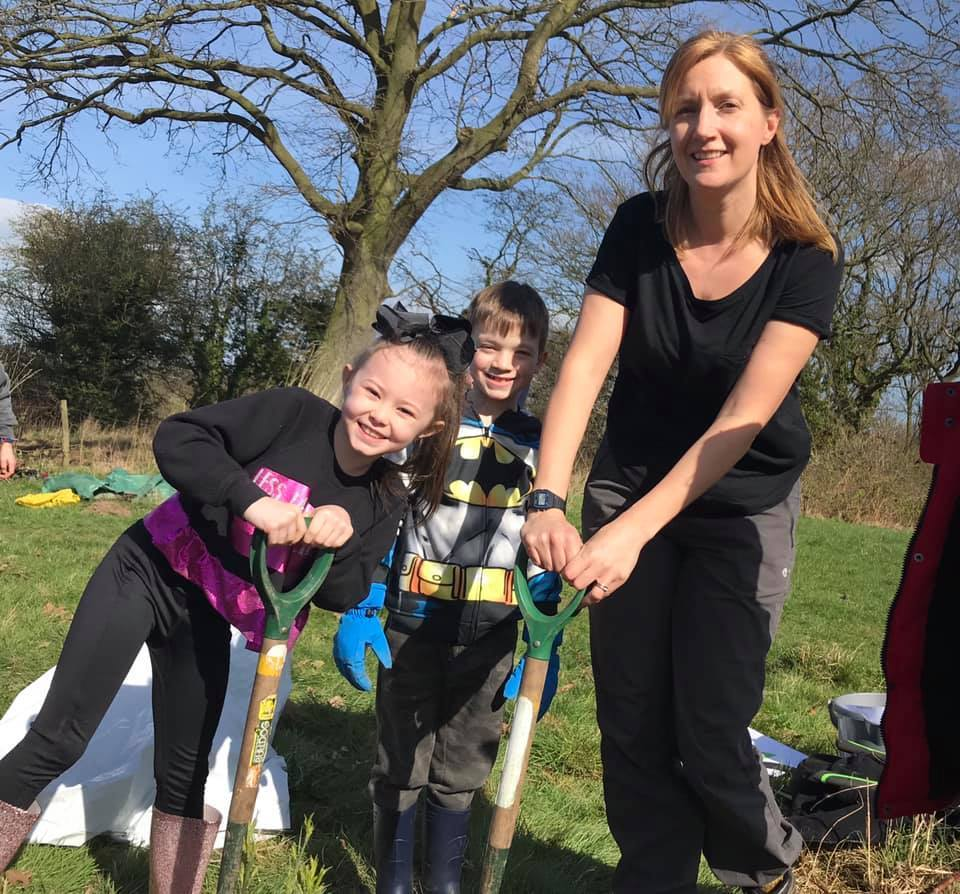 Steph Hepworth, Mersey Forest's Trees for Learning Project Officer, with pupils at a tree planting session.